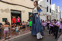 "Spain. Balearic Islands. Minorca (Menorca). Mahon. The parade of the Giants in the ""Festes de la Mare de Déu de Gràcia"" during the traditional summer festival. Maó (in Catalan) and Mahón (in Spanish), written in English as Mahon, is a municipality, the capital city of the island of Menorca, and seat of the Island Council of Menorca. The city is located on the eastern coast of the island, which is part of the autonomous community of the Balearic. In Spain, an autonomous community is a first-level political and administrative division, created in accordance with the Spanish constitution of 1978, with the aim of guaranteeing limited autonomy of the nationalities and regions that make up Spain. 7.09.2019 © 2019 Didier Ruef"