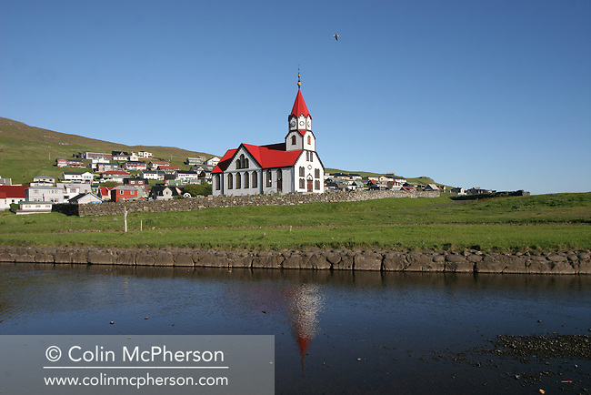 The church and graveyard in the village of Sandavágur on the island of Vágar, close to the Faroe Islands' airport. The Faroes, a group of 18 islands between the Norwegian Sea and the North Atlantic Ocean became an autonomous region of the Kingdom of Denmark in 1948. At the start of the 21st century the population stood at around 50,000 with the economy relying almost entirely on aquaculture and fishing.