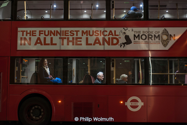 Elderly man on a London night bus.