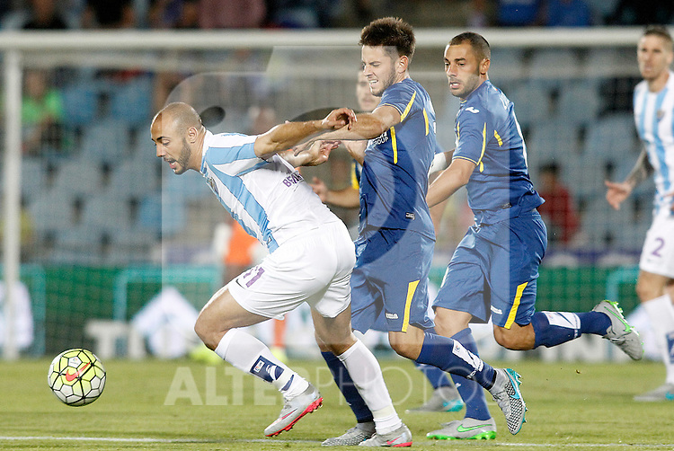 Getafe's  Alvaro Medran (c) and Medhi Lacen (r) and Malaga's Nordim Amrabat during La Liga match.September 18,2015. (ALTERPHOTOS/Acero)
