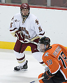Tim Filangieri 5 of Boston College keeps an eye on Tomas Petruska 18 of Bowling Green. The Eagles of Boston College defeated the Falcons of Bowling Green State University 5-1 on Saturday, October 21, 2006, at Kelley Rink of Conte Forum in Chestnut Hill, Massachusetts.<br />