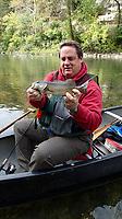 NWA Democrat-Gazette/FLIP PUTTHOFF <br />Bland admires an Elk River smallmouth bass he caught Oct. 19 2018 on a crawdad crank bait.