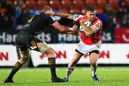 April 29th 2017, FMG Stadium Waikato, Hamilton, New Zealand; Super Rugby; Chiefs versus Sunwolves;  Sunwolves second five Derek Carpenter beats the tackle of Chiefs lock Dominic Bird during the Super Rugby rugby match