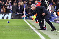 Jose Mourinho (Manager) of Chelsea throws on a water bottle to an injured player rather then allow the him to receive treatment from th Chelsea medical staff during the UEFA Champions League group match between Chelsea and FC Porto at Stamford Bridge, London, England on 9 December 2015. Photo by David Horn / PRiME