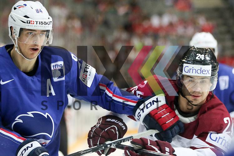 Lativa Redlihs, Mikelis (Nr.24) im Zweikampf mit Frankreichs Hecquefeuille, Kevin (Nr.84)  im Spiel IIHF WC15 France vs. Lativa.<br /> <br /> Foto &copy; P-I-X.org *** Foto ist honorarpflichtig! *** Auf Anfrage in hoeherer Qualitaet/Aufloesung. Belegexemplar erbeten. Veroeffentlichung ausschliesslich fuer journalistisch-publizistische Zwecke. For editorial use only.