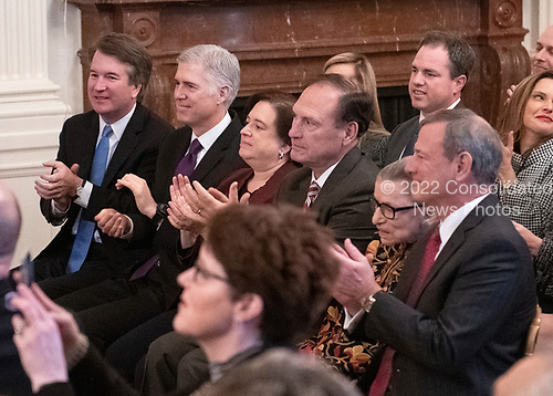 Members of the United States Supreme Court, from left to right, Associate Justice of the Supreme Court Brett Kavanaugh, Associate Justice of the Supreme Court Neil M. Gorsuch, Associate Justice of the Supreme Court Elena Kagan, Associate Justice of the Supreme Court Samuel A. Alito, Jr., Associate Justice of the Supreme Court Ruth Bader Ginsburg, and Chief Justice of the US John G. Roberts, Jr. applaud the arrival of Maureen Scalia who will accept the Presidential Medal of Freedom for her late husband, the late Associate Justice of the Supreme Court Antonin Scalia prior to United States President Donald J. Trump awarding the medal during a ceremony in the East Room of the White House in Washington, DC on Friday, November 16, 2018.  The award is the nation's highest civilian honor and is awarded by the President to individuals who made meritorious contributions to the United States.<br /> Credit: Ron Sachs / CNP<br /> (RESTRICTION: NO New York or New Jersey Newspapers or newspapers within a 75 mile radius of New York City)
