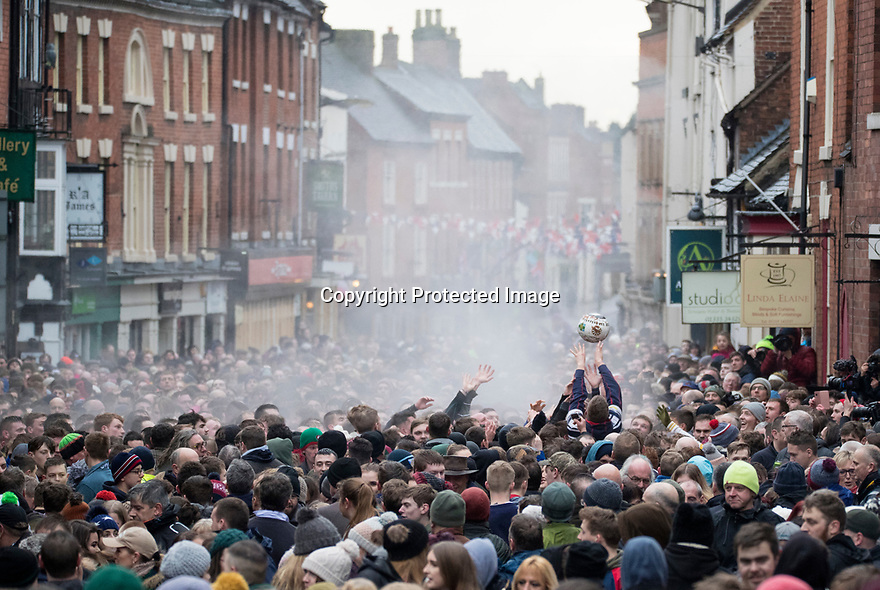 13/02/18<br /> <br /> Steam from the sweat of players fills the street as the Royal Shrovetide Football match is played in the streets of Ashbourne, Derbyshire. The Up'ards play against the Down'ards over two days and try to goal balls in goals that are three miles apart.<br /> <br /> All Rights Reserved F Stop Press Ltd. +44 (0)1335 344240 +44 (0)7765 242650  www.fstoppress.com