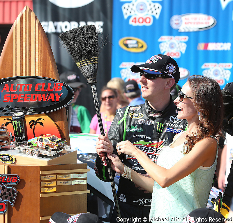 March 24, 2013 Fontana, CA: 17th Annual Auto Club 400 held at the Auto Club Speedway. Sprint Cup Series driver Kyle Busch #18 and wife Samantha Busch after sweeping the Royal Purple 300 and the Auto Club 400.
