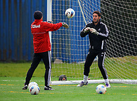 Pictured L-R: Goalkeeping Coach Adrian Tucker with goalkeeper Jose Moreira. Thursday 05 April 2012<br /> Re: Swansea City Football Club training at Llandarcy, south Wales ahead of their Barclay's Premiership game against Newcastle.