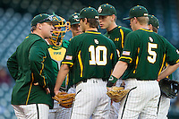 Baylor Bears assistant coach Trevor Mote meets with the Baylor infield during the game against the Houston Cougars in the NCAA baseball game on March 2, 2013 at Minute Maid Park in Houston, Texas. Houston defeated Baylor 15-4. (Andrew Woolley/Four Seam Images).