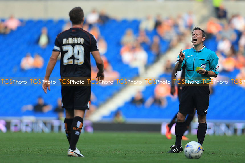 Keith Stroud has words with Anthony McMahon of Blackpool before booking him - Brighton & Hove Albion vs Blackpool - Sky Bet Championship Football at the American Express Community Stadium, Falmer, Brighton - 20/09/14 - MANDATORY CREDIT: Simon Roe/TGSPHOTO - Self billing applies where appropriate - contact@tgsphoto.co.uk - NO UNPAID USE