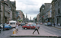 Edinburgh: Looking East on George St. from the Castle St. Intersection. A Georgian Boulevard turned into a linear parking lot.