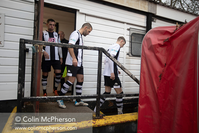 The home players coming out of their dressing room before Atherton Collieries played Boston United in the FA Trophy third qualifying round at the Skuna Stadium. The home club were formed in 1916 and having secured three promotions in five season played in the Northern Premier League premier division. This was the furthest they had progressed in the FA Trophy and defeated their rivals from the National League North by 1-0, Mike Brewster scoring a late winner watched by a crowd of 303 spectators.