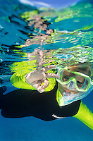 """5 year old snorkeler giving the """"ok"""" sign<br /> with reflections on the surface<br /> St. John<br /> U.S. Virgin Islands"""