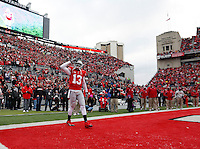 Ohio State Buckeyes quarterback Kenny Guiton (13) says goodbye during Senior day before their College football game against Indiana Hoosiers at Ohio Stadium in Columbus, Ohio on November  Center on November 23, 2013.  (Dispatch photo by Kyle Robertson)