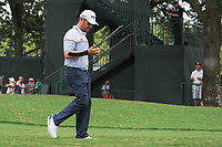 Louis Oosthuizen (RSA) looks over his hurt arm as he departs the 10th tee during Sunday's final round of the PGA Championship at the Quail Hollow Club in Charlotte, North Carolina. 8/13/2017.<br /> Picture: Golffile | Ken Murray<br /> <br /> <br /> All photo usage must carry mandatory copyright credit (&copy; Golffile | Ken Murray)