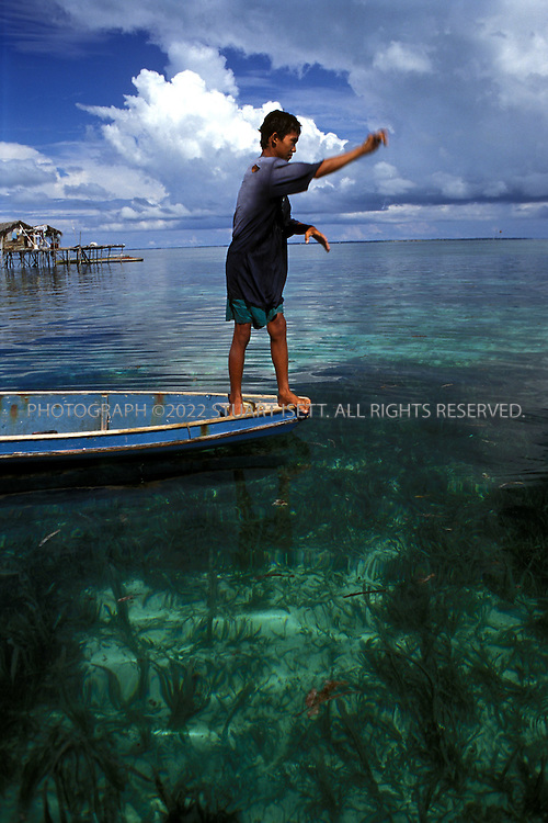 Tong Tong, Sulu Sea, Philippines...A teenager fishes for his fmailie's dinner in Tong Tong...All photographs ©2003 Stuart Isett.All rights reserved.