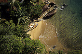 Ilha Grande, Brazil. Aerial view of a group of people on a small beach in a forested cove.