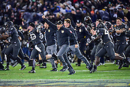 Baltimore, MD - DEC 10, 2016: Army Black Knights head coach Jeff Monken storms the field after defeated Navy 21-17 at M&T Bank Stadium, Baltimore, MD. (Photo by Phil Peters/Media Images International)