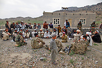 """Members of the Afghan National Army lead a weapons search at a village close to the border with Pakistan as part of a 4-day joint mission with 2nd Platoon, Comanche Company, 1-501 IN (ABN) (Task Force Blue Geronimo) out of Fort Richardson Alaska...International forces are increasingly relying on Afghan National Security Forces (ANSF) such as the Afghan National Army  (ANA) in conducting village searches, key village leader engagements and biometrics intelligence gathering operations in preparation for the 2013 handover of security operations to the ANSF. Although no weapons were found on this day, the means by which the ANA conducted their search was superficial at best and involved no metal detectors. Village elders sit with members of the Afghan National Army (ANA) and U.S. infantry soldiers to drink """"Chai"""" (green tea) after the ANA led a weapons search in this area (which lies close to the border with Pakistan). This was the conclusion of a 4-day joint mission with 2nd Platoon, Comanche Company, 1-501 IN (ABN) (Task Force Blue Geronimo) out of Fort Richardson Alaska...Although no weapons were found on this day, the means by which the ANA conducted their search was superficial at best and involved no metal detectors. International forces are increasingly relying on Afghan National Security Forces (ANSF) such as the Afghan National Army  (ANA) in conducting village searches, key village leader engagements and biometrics intelligence gathering operations in preparation for the 2013 handover of security operations to the ANSF."""