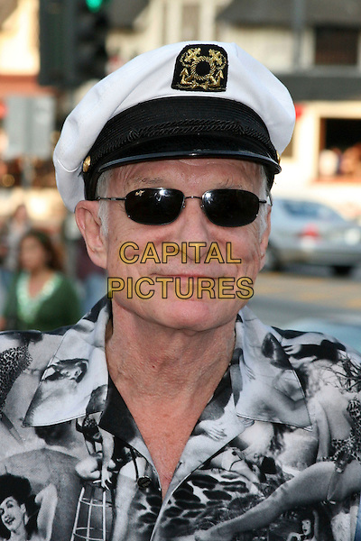 "HUGH HEFNER .""The Girls Next Door"" DVD and Magazine Signing at Tower Records, West Hollywood, California, USA..August 3rd, 2006.Photo: Byron Purvis/AdMedia/Capital Pictures.Ref: ADM/BP.headshot portrait sunglasses shades sailor hat .www.capitalpictures.com.sales@capitalpictures.com.©Byron Purvis/AdMedia/Capital Pictures."
