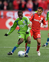 Steve Zakuani (11) of the Seattle Sounders FC and Amado Guevara (20) of Toronto FC battle for a ball during MLS action at BMO Field on April 4, 2009. Seattle won 2-0.