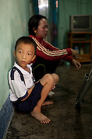 Thang, 9,  with his mother Tuyet in their Nha Trang home in Vietnam...---..Nguyen Van Thang is nine-years-old and just finished second grade. He lives in the coastal town of Nha Trang with his mother, grandmother, and 10-month-old brother. Thang's father, Bui Van Tri, spends much of his time away from his family, as he is a fisherman and works up and down the coastline. His income is about 400,000VND (~$23USD) per month; however, this salary is seasonal and there are months when he earns nothing at all. ..Thang's mother, Nguyen Thi Bach Tuyet, is 31-years-old and is a housewife. She cannot work as she must look after Thang, his brother, and his grandmother. Therefore, the family of five is solely dependent on Thang's father's income. The family lives in a lean-to extension of Thang's uncle's house that is just eight square meters with a tin roof, cement floor, and brick walls...Thang suffers from Ventricular Septal Defect (VSD), a common congenital heart defect (CHD) that occurs when there is a hole in the wall between the right and left ventricles of the heart. Symptoms of VSD include shortness of breath, fast heartbeats, loss of appetite, poor weight gain, chest pain, and discolored blue skin. In addition, other areas of the child's development such as physical growth and brain development are affected if VSD is left untreated, and the child also has a high chance of developing irreversible pulmonary hypertension...Thang was diagnosed with VSD when he was just two-months-old. He and Tuyet, his mother, made the arduous 10-hour trek from Nha Trang to the Heart Institute in Ho Chi Minh City at least five times over the course of his life, and the diagnosis was always the same: Surgery, or else he would die. Lifesaving surgery, however, was out of the question as it cost $3,100USD--a sum that was beyond anything Thang's family could scrape together. After each hospital visit Tuyet would make the long bus journey back to Nha Trang with her son, wondering how much time