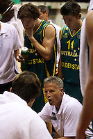 Boomers' Matthew Dellavedova (beck left) and Damien Martin listen to coach Brett Brown during the International basketball match between the NZ Tall Blacks and Australian Boomers at TSB Bank Arena, Wellington, New Zealand on 25 August 2009. Photo: Dave Lintott / lintottphoto.co.nz