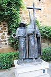 Hooded figures Semana Santa bronze sculpture in San Juan square, Caceres, Extremadura, Spain
