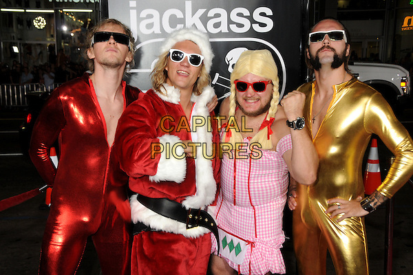 "THE DUDESONS .""Jackass 3D"" Los Angeles Premiere held at Grauman's Chinese Theatre, Hollywood, California, USA, .13th October 2010..half length fancy dress costumes funny band group sunglasses red shiny santa gold catsuit jumpsuit  .CAP/ADM/BP.©Byron Purvis/AdMedia/Capital Pictures."