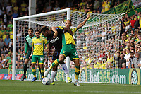 Moritz Leitner of Norwich City challenges Britt Assombalonga of Middlesbrough for the ball during Norwich City vs Middlesbrough, Sky Bet EFL Championship Football at Carrow Road on 15th September 2018