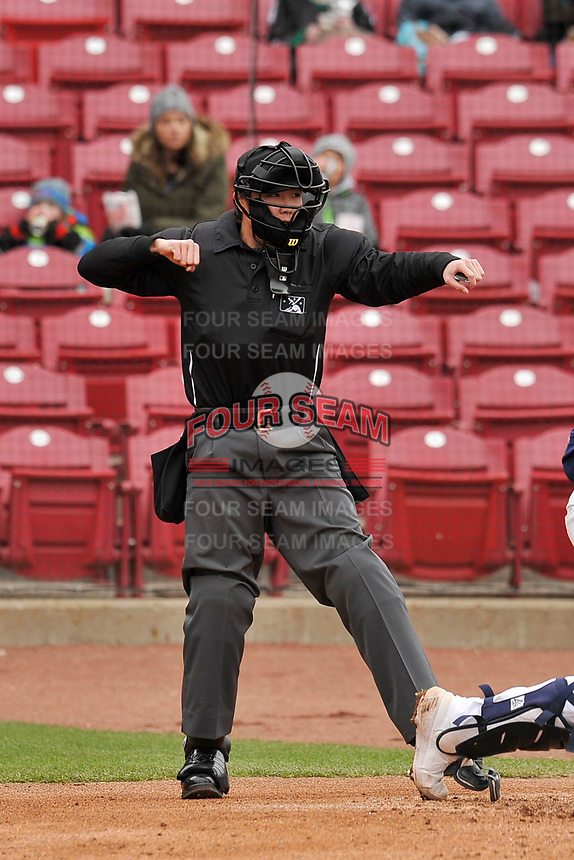 Home plate umpire Emma Charlesworth-Seiler calls a batter out on strikes during the game between the Cedar Rapids Kernels and the Burlington Bees at Veterans Memorial Stadium on April 14, 2019 in Cedar Rapids, Iowa.  The Bees won 6-2.  (Dennis Hubbard/Four Seam Images)