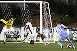 16 November 2007: North Carolina's Brian Shriver (31) stops the ball to avoid the flying tackle attempt from Wake Forest's Lyle Adams (30). Wake Forest University played the University of North Carolinaat SAS Stadium in Cary, NC in an Atlantic Coast Conference Men's Soccer tournament semifinal.