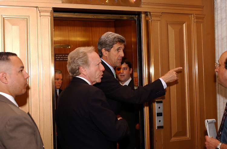 ANWR2/041802 -- Joseph Lieberman, D-CT., and John Kerry, D-Mass., are greeted by environmental lobbyist outside the Senate Floor after the cloture vote on drilling for oil in the Arctic National Wildlife Refuge.