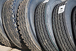 Range of large vehicle tyres leaning against each other