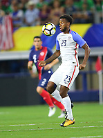 ARLINGTON, TEXAS - Saturday July 22, 2017: Kellyn Acosta #23 of the USMNT in action against the Costa Rican National Team in the first half of the match at AT&T Stadium.