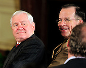 United States Secretary of Defense Robert Gates, left, and Admiral Mike Mullen, Chairman of the Joint Chiefs of Staff, right, look back at a reporter prior to U.S. President Barack Obama (not pictured) conducting a joint press conference with President Hamid Karzai of Afghanistan (not pictured) in the East Room of the White House in Washington, DC on Wednesday, May 12, 2010..Credit: Ron Sachs / CNP