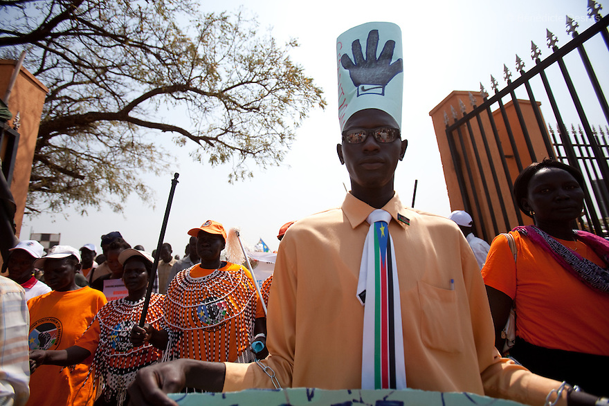 9 december 2010 - Juba, South Sudan - Southern Sudanese citizens march in the streets in support of the independence referendum in Juba, South Sudan. The referendum on whether the oil-producing region should declare independence, scheduled for Jan. 9, is the climax of a 2005 peace deal that ended decades of north-south conflict - Africa's longest civil war that was fought over ethnicity, religion, ideology and oil and that killed 2 million people. Photo credit: Benedicte Desrus
