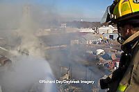 63818-02319 Firefighters extinguishing warehouse fire using aerial ladder truck viewed from top of ladder, Salem, IL