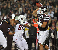 NWA Media/Michael Woods --11/01/2014-- w @NWAMICHAELW... Mississippi State quarterback Dak Prescott completes a pass under pressure in the 1st quarter of Saturday nights game against Mississippi State at Davis Wade Stadium in Starkville, Mississippi.
