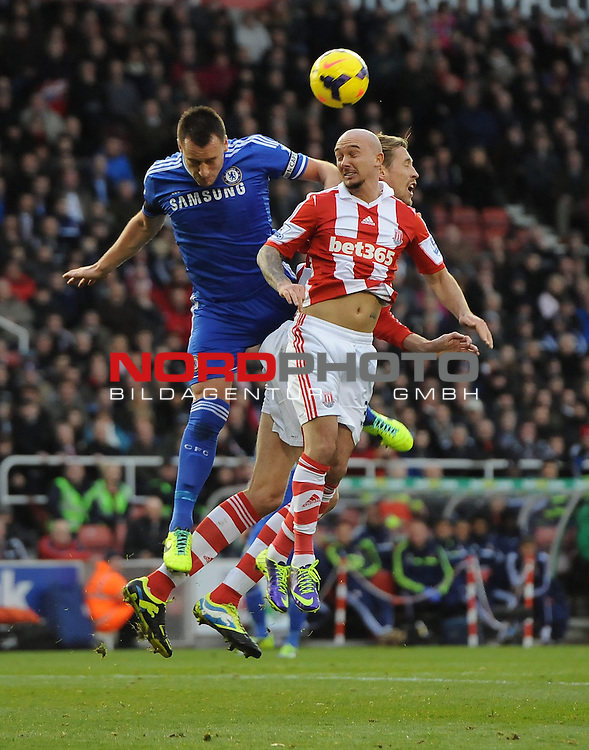 Chelsea's John Terry battles for the high ball with Stoke City's Peter Crouch and Stoke City's Stephen Ireland -   07/12/2013 - SPORT - Football - Stoke-On-Trent - Britannia Stadium - Stoke City v Chelsea - Barclays Premier League<br /> Foto nph / Meredith<br /> <br /> ***** OUT OF UK *****