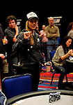 Team Pokerstars.net Pro Vanessa Rousso waves to her tablemates after being eliminated. She was eliminated in 10th. place.