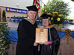 Interim President Chester Burton recognizes Faculty Emeriti recipient Mike Malay before the Western Nevada College commencement at the Pony Express Pavilion, in Carson City, Nev., on Monday, May 19, 2014. <br /> Photo by Cathleen Allison/Nevada Photo Source