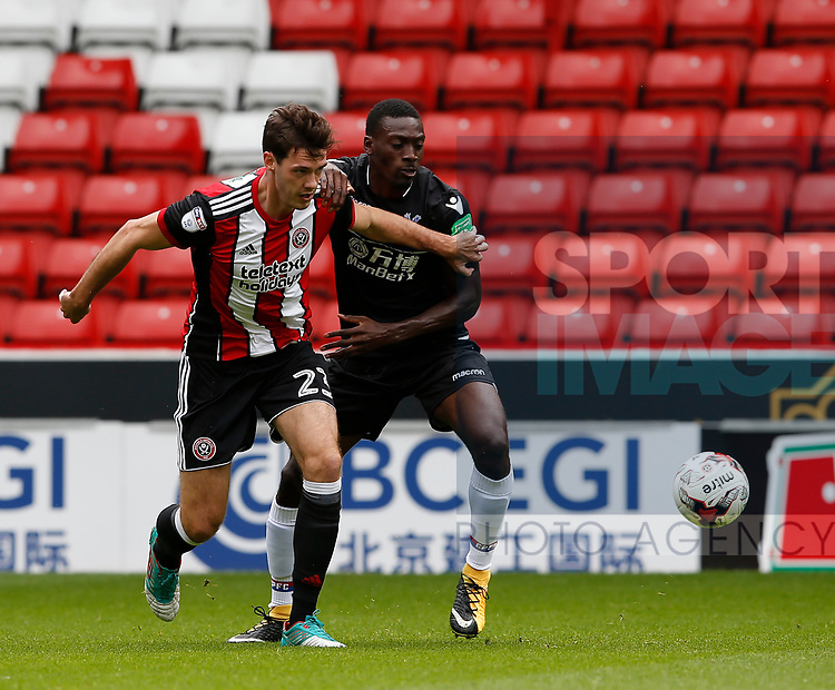 Ben Heneghan of Sheffield Utd challenges Freddie Ladapo of Crystal Palace during the Professional Development U23 match at Bramall Lane, Sheffield. Picture date 4th September 2017. Picture credit should read: Simon Bellis/Sportimage