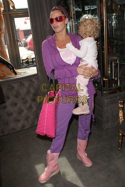 *Exclusive*.KATIE PRICE & PRINCESS TIAMII ANDRE.Katie Price aka Jordan Oscar Dress Fitting held at Lloyd Klein Couture, Los Angeles, California, USA, .21st February 2009..LA full length baby daughter sunglasses white trainers purple tracksuit hairband headband red frames family dummy pink boots bag tote hair band .CAP/ADM/KB.©Kevan Brooks/Admedia/Capital PIctures