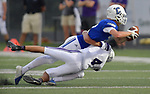 Columbia's Jackson Holmes (top) is brought down by Mascouah's Dominic Squires. Columbia played Mascoutah on Saturday August 31, 2019 in a football game that was never started on Friday night due to bad storms.<br /> Tim Vizer/Special to STLhighschoolsports.com