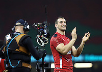 Pictured: A delighted Wales captain Sam Warburton waves to the crowd after the final whistle Saturday 29 November 2014<br />