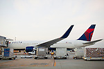 A Ground crew member next to a Delta 777 plane near Gate F8 outside of the Maynard H. Jackson Jr. International Terminal at Hartsfield–Jackson Atlanta International Airport, in Atlanta, Georgia on August 28, 2013.