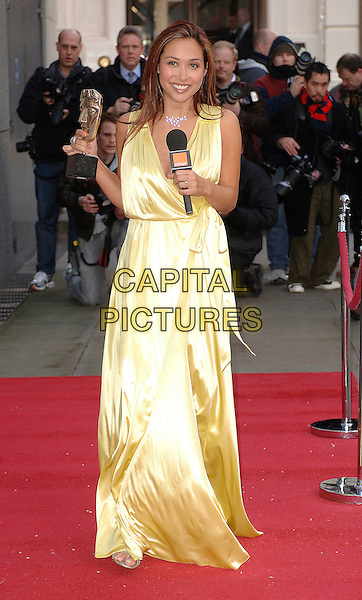"MYLEENE KLASS.the ""I'm A Celebrity Get Me Out Of Here"" star  poses outside The Royal Opera House in Covent Garden, London, England 6th February 2007..She will be presenting the Orange Red Carpet Show from the BAFTA red carpet this Sunday..full length yellow silk satin dress red carpet microphone holding award trophy.CAP/ BEL.©Tom Belcher/Capital Pictures."