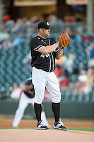 Charlotte Knights starting pitcher Brad Penny (46) looks to his catcher for the sign against the Gwinnett Braves at BB&T BallPark on August 11, 2015 in Charlotte, North Carolina.  The Knights defeated the Braves 3-2.  (Brian Westerholt/Four Seam Images)